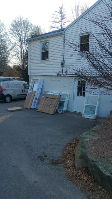 Stonington, CT - Crew is on site in Pawcatuck Ct installing new Vinyl windows. Window replacement in Pawcatuck Ct using Harvey Windows.