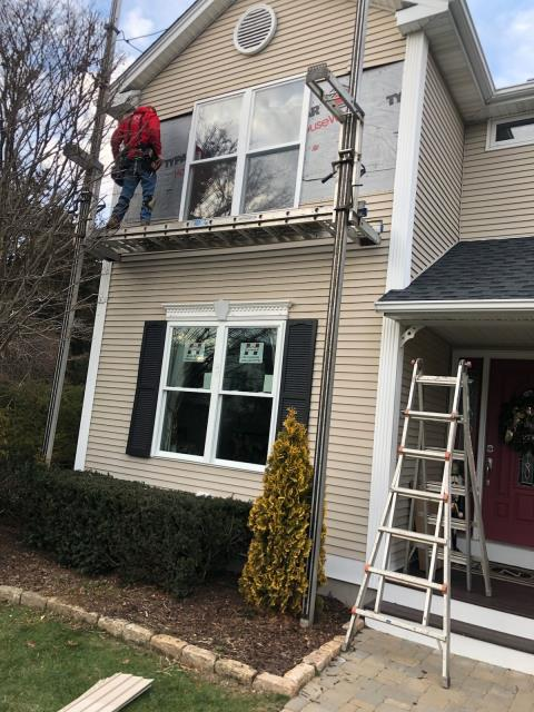 South Kingstown, RI - Installing new construction windows on this home in South Kingstown RI. Harvey vinyl windows were used on this project.