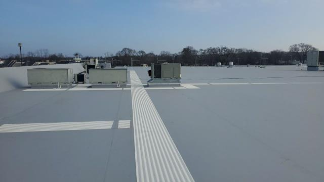 Norwich, CT - Commercial roof installation in Norwich CT. New white TPO roof installation.