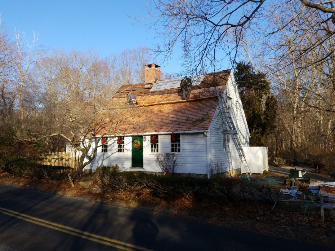 Old Lyme, CT - Home in need of wood roof repair replaced rotted slat boards and installed new Cedar shake roof.
