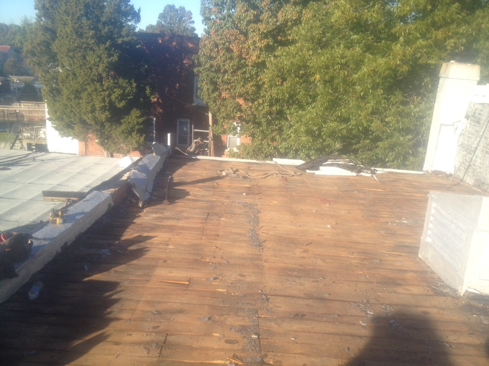Washington, DC - I just tearing off another roof in DC NW