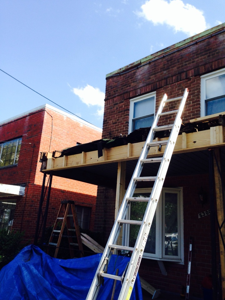 Washington, DC - Just replacing the main beam, rafters and roof deck..