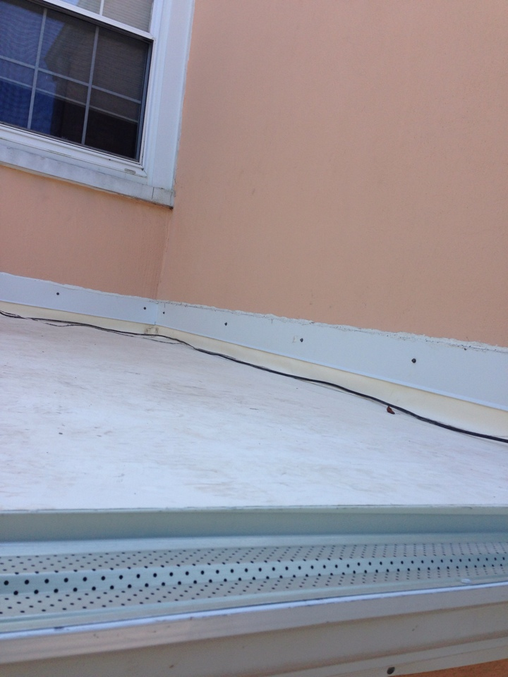 Washington, DC - Installing a new fiber tite roof! In lower back porch.