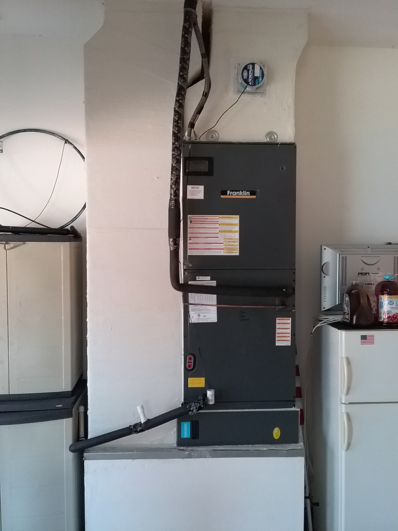 Installation of a 20 seer Franklin inverter heat pump split system with 10 year parts and labor coverage.