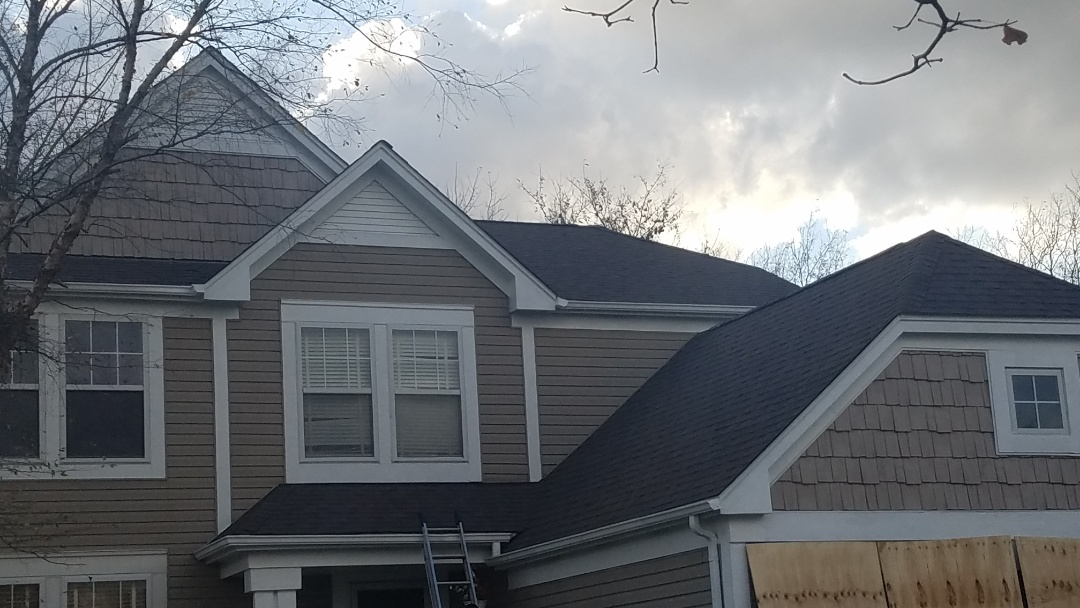 Lake in the Hills, IL - Re-roofing project finished in Lake in the Hills on Stanton Circle the Aged Redwood color looks perfect with the rest of the exterior.