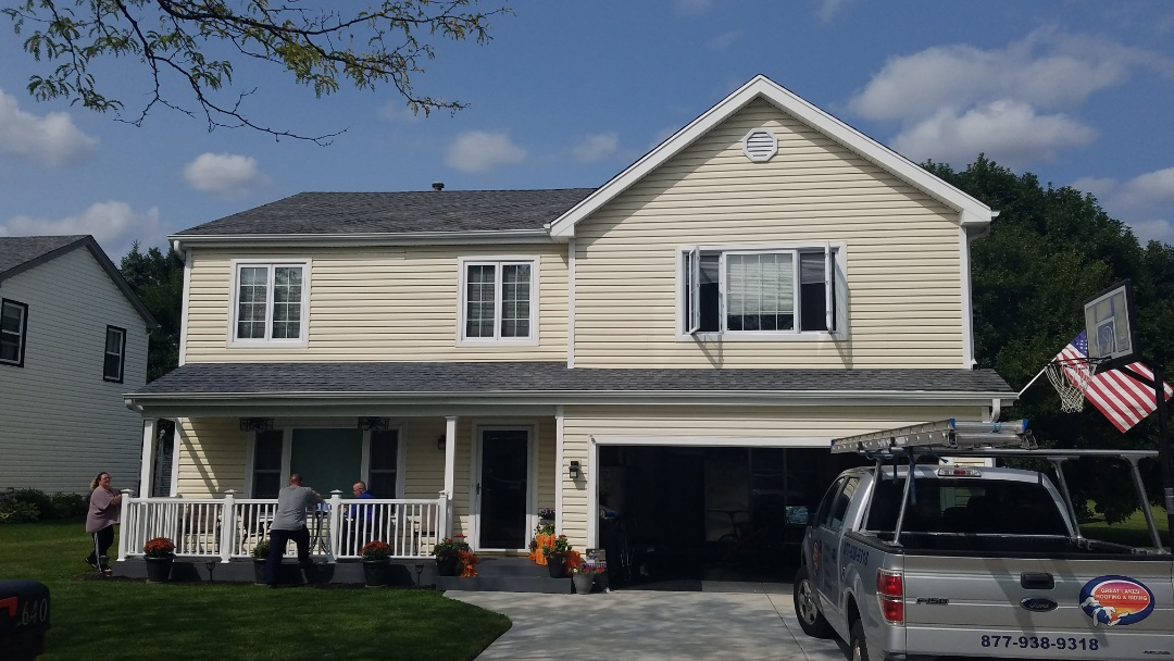 Roselle, IL - Picking up final payment for roofing project completed in Roselle on Waterford Court