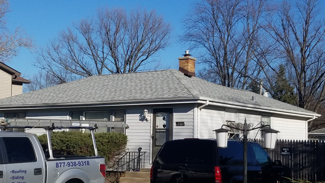 Villa Park, IL - Work commencing on replacing gutters and downspouts on house and detached garage in Villa Park on Buttercup Ln