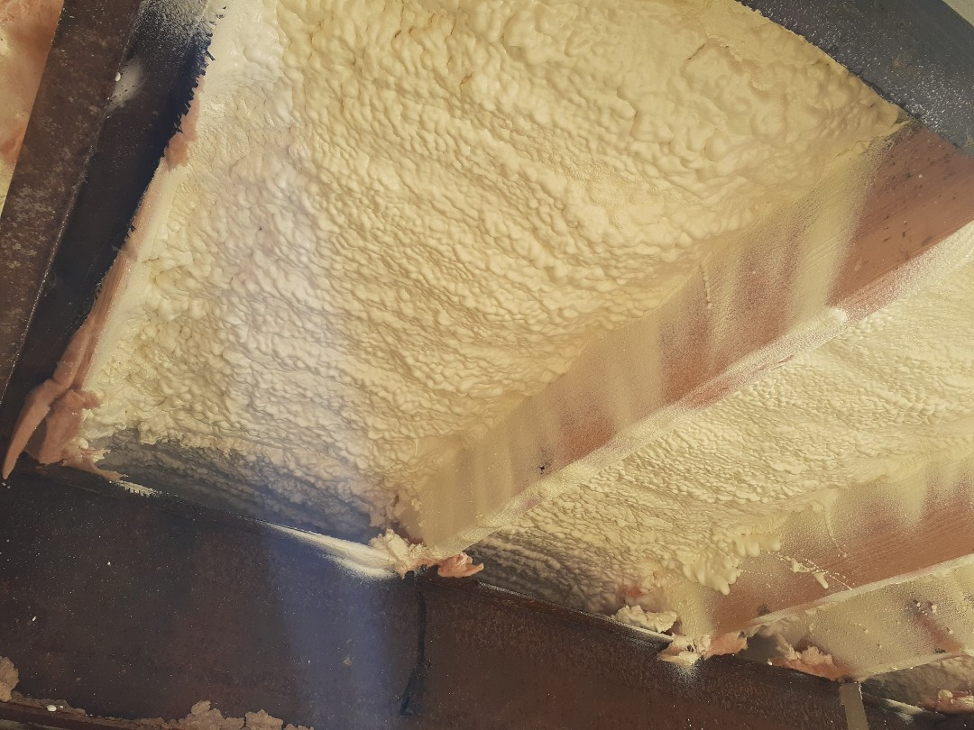 Houston, TX - Closed cell spray foam under crawlspace on trailer