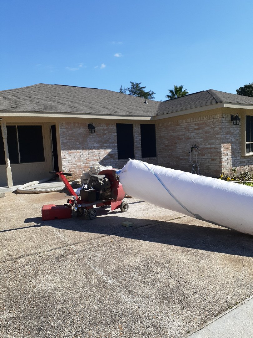 Houston, TX - Removing old insulation from attic