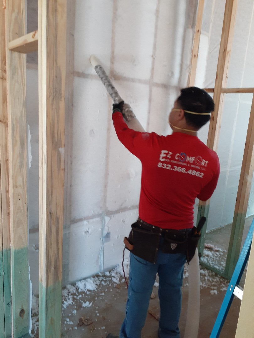 Houston, TX - Bibs R-19 loose fiberglass in exterior walls