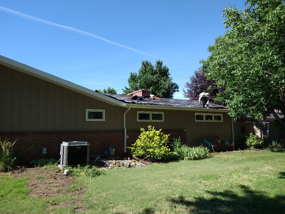 Russell, KS - It's a beautiful day for roofing!  The guys are hard at it in Russell, KS installing a new Malarkey 50 year impact resistant roof.