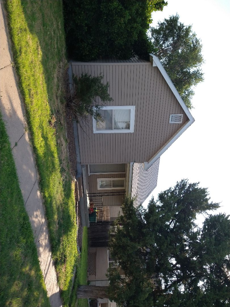 Hays, KS - A good old roof soon to be replaced.  Give us a call today for you free estimate!  We've got you covered!