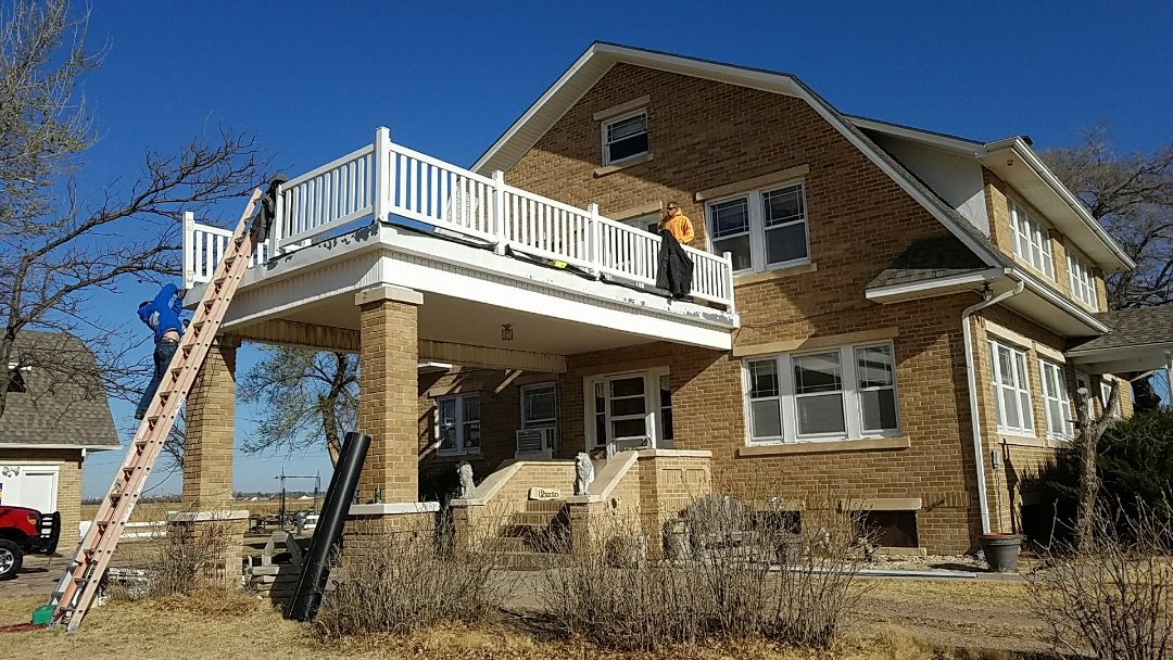 Lakin, KS - Tyler and his crew installing a 60 mil TPO roofing system over this portico roof that is attached to this beautiful, historic home in Lakin, Kansas.  The customers are looking forward to summer evenings drinking iced tea and watching our beautiful western Kansas sunsets.  #Roofmasters #Roofing
