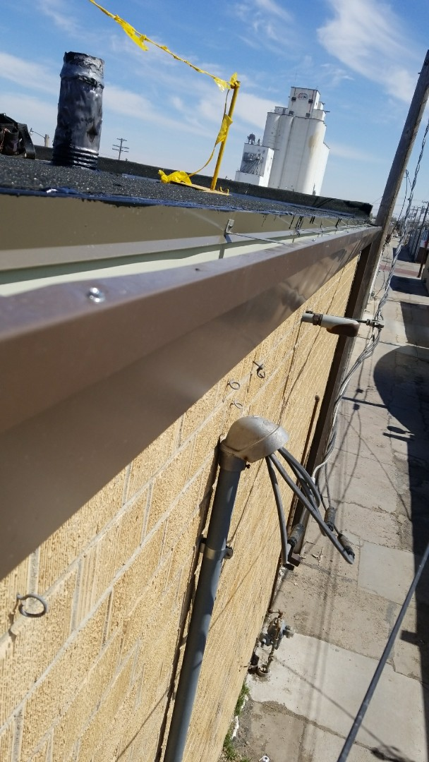 Hays, KS - New commercial guttering to route the water where it should drain.