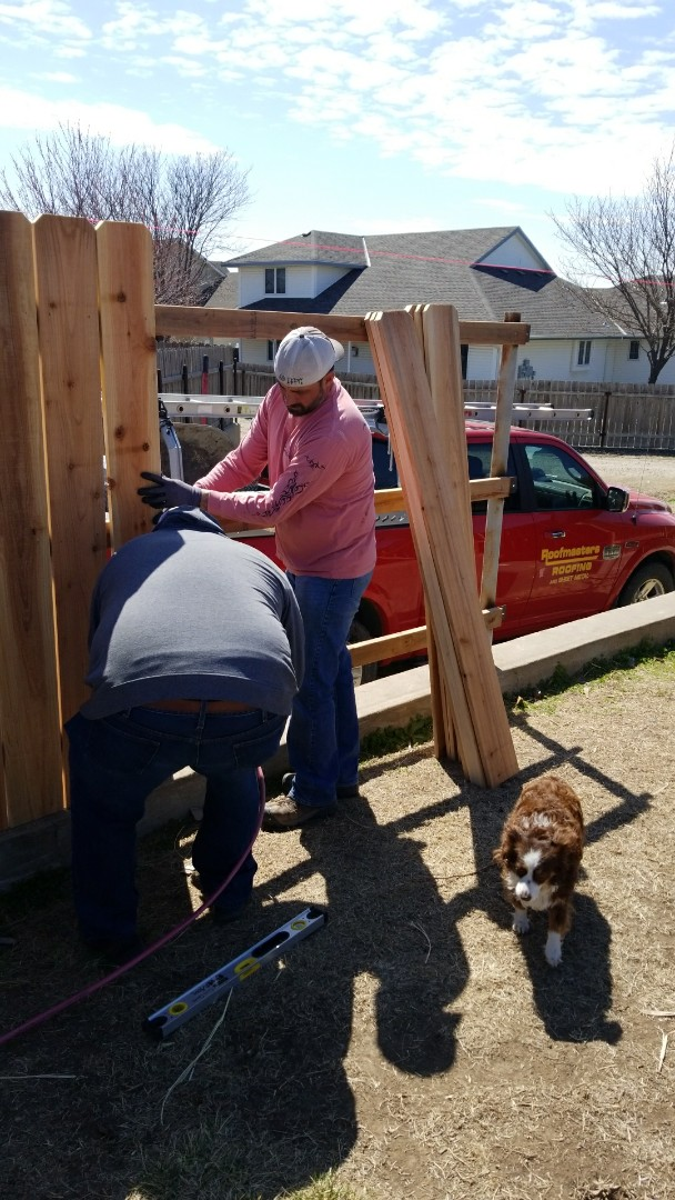 Hays, KS - New cedar fence replacing rotten fence boards.  Whose next?