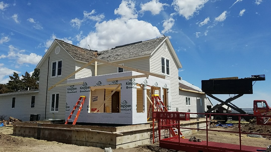 Ellis, KS - The guys are working hard on this beautiful day to complete a 74 sq. Malarkey roof install.  This 100 year old farm was stripped of its original wood shakes and replaced with one of the best impact resistant roofs on the market.