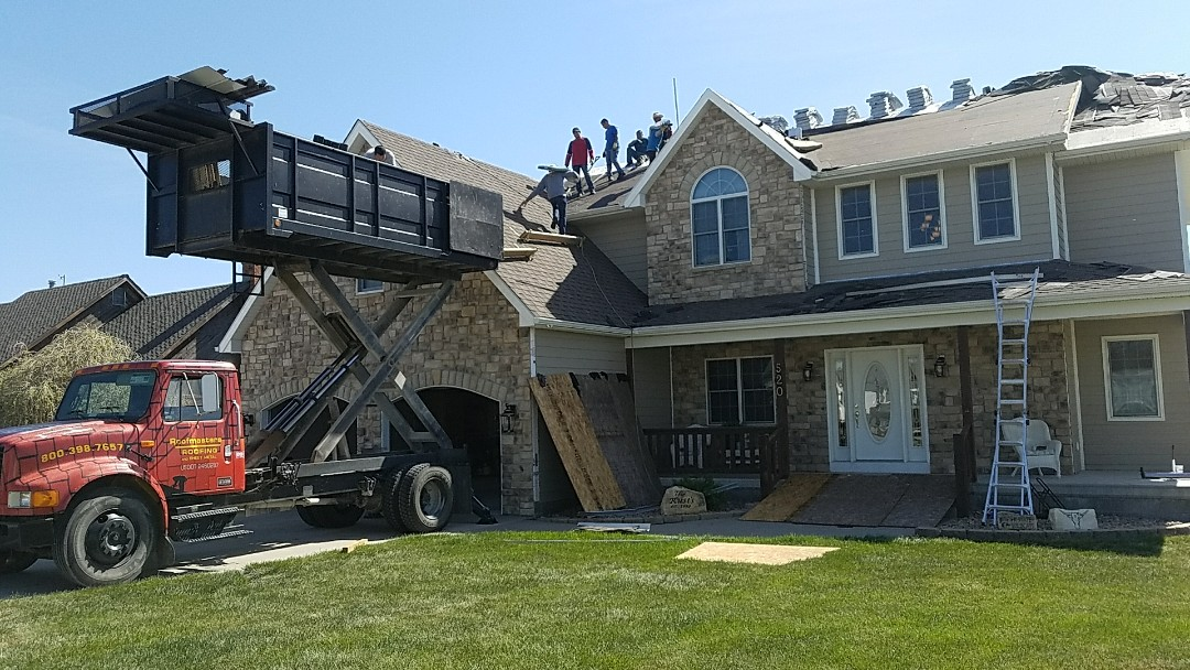 Kensington, KS - It a beautiful day for roofing!  Working in Kensington this morning installing Tamko 'Rustic Slate' shingles and seamless guttering.