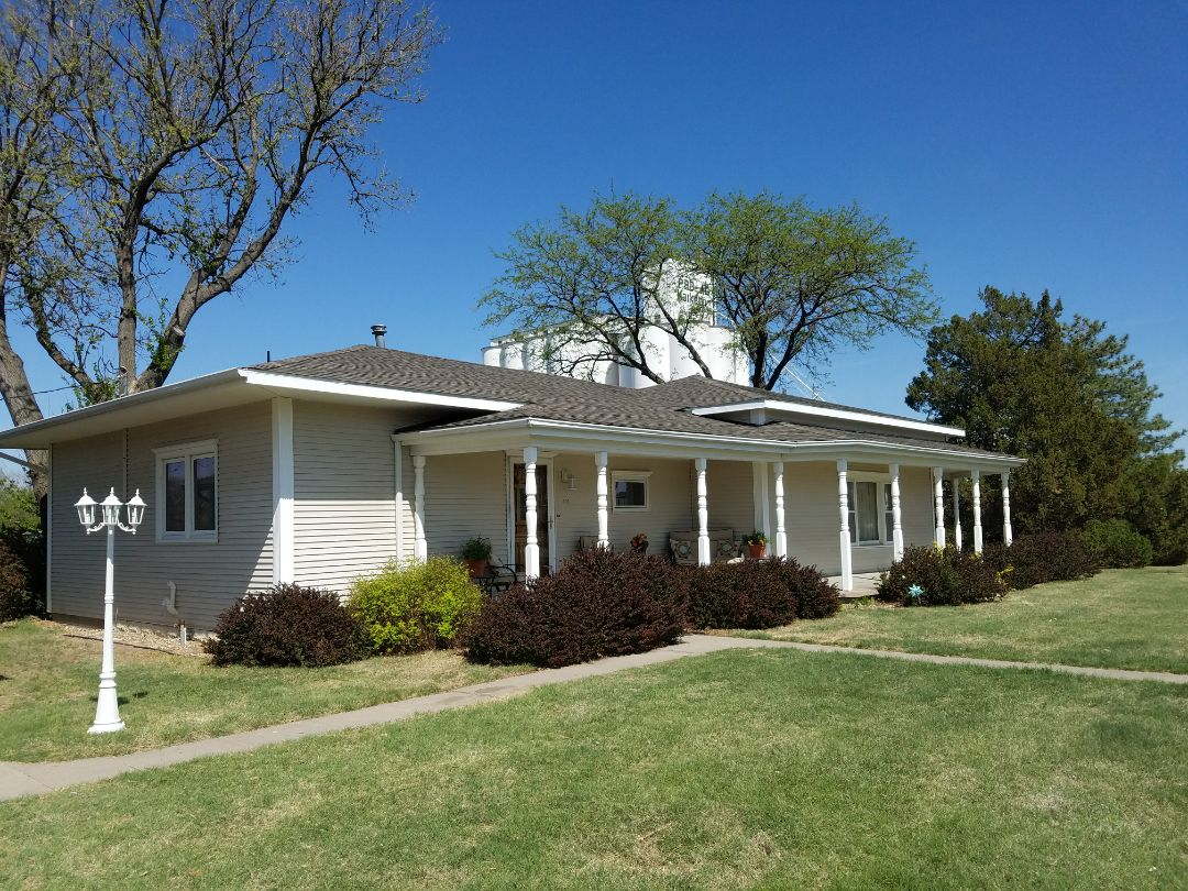 Kensington, KS - Removed the wood shakes and installed a new Tamko 30 year roofing system on this beautiful ranch style house.