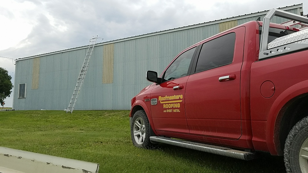 Morland, KS - Installing new metal roof on a machine shed impacted by the recent hail storms.