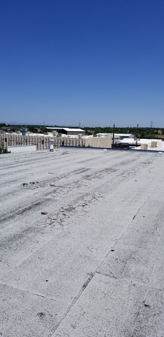 Hays, KS - Modified roof failure.  Granule adhesion failrue.  Solution, prime, add cold adhesives with new granules or a reflective coating.  Uv Ray's degradation has to be minimialized!