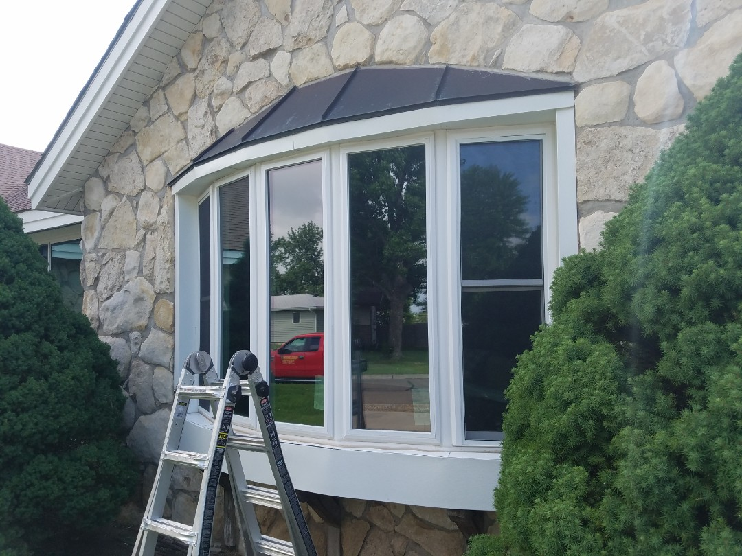 Victoria, KS - This old bay window will be soon getting a face lift including a new copper standing seam roof.  This material is durable and will provide a stylish look to this beautiful home.