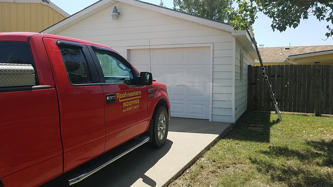 Dighton, KS - Another small town impacted by the string of hail storms this summer.  Give us a call for a free estimate!  We'll walk you through the entire process of obtaining a new roof!