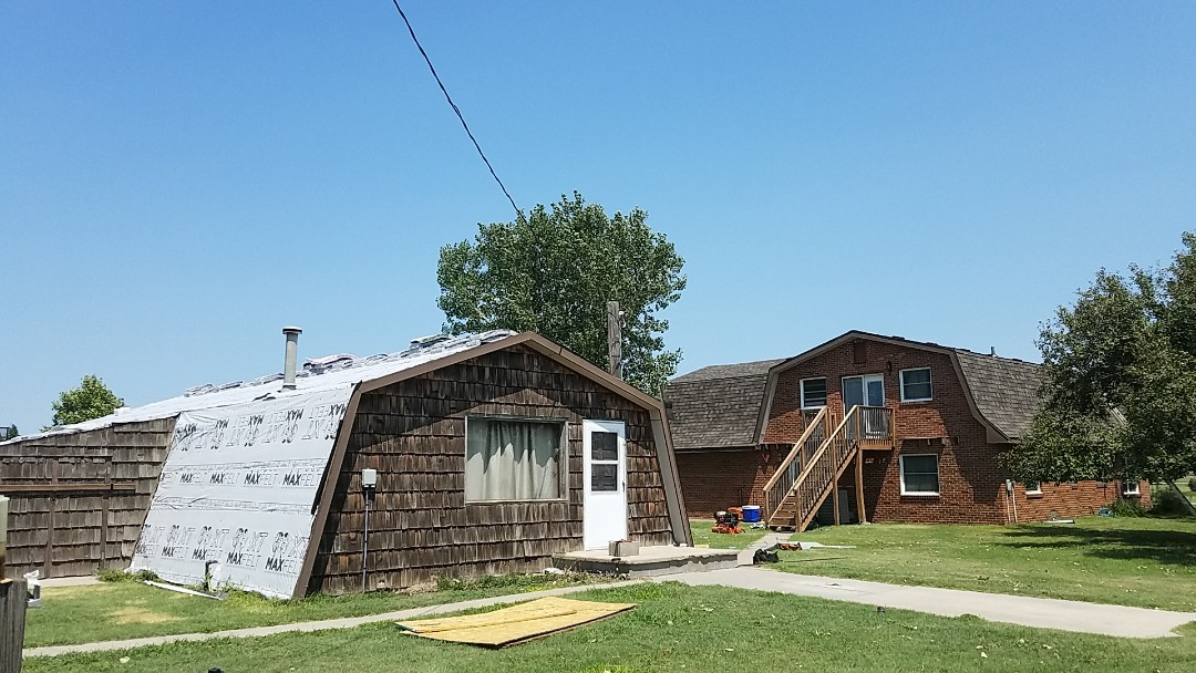 Grinnell, KS - Finishing up a installation of Tamko shingles on this home.  These mansard roofs are challenging but count on Roofmasters to get the job done professionally and promptly.