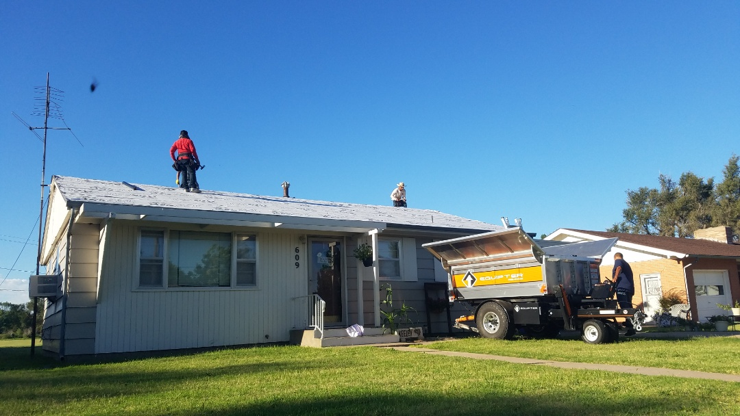La Crosse, KS - The Roofmasters crews are working hard this morning installing a 30 year Tamko roof for these customers!