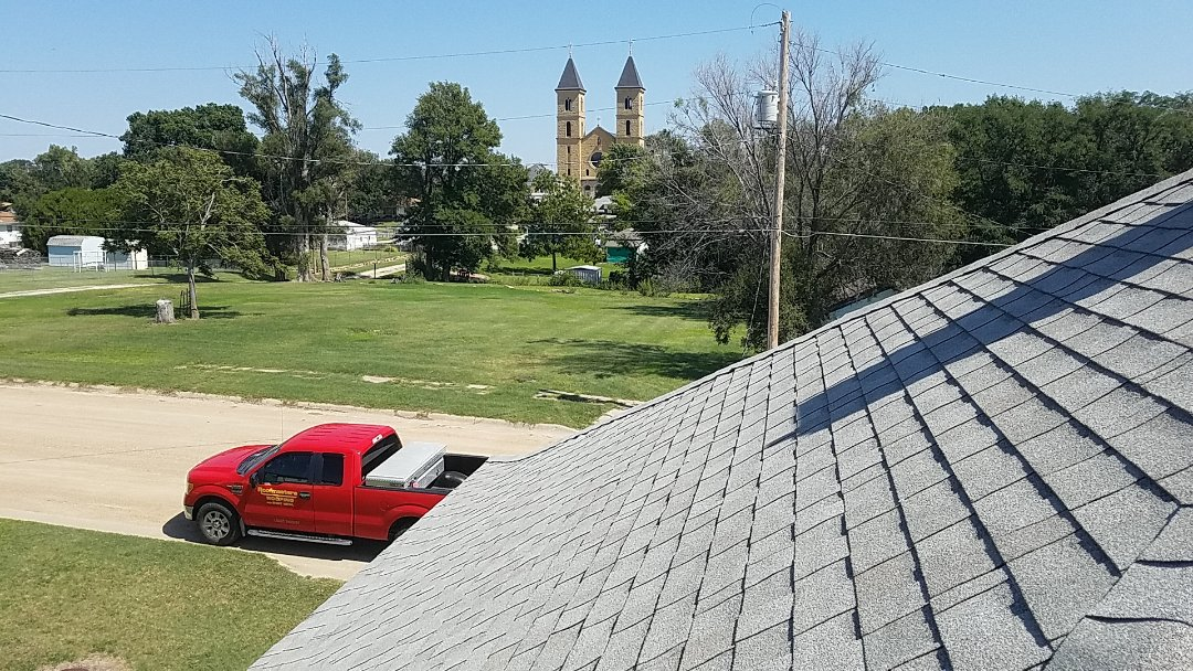 Victoria, KS - Measuring up a free estimate on a century old home in the shadows of one of the 8 wonders of Kansas.  What a great little town!  #Roofmasters #Roofing #CathedralofthePlains