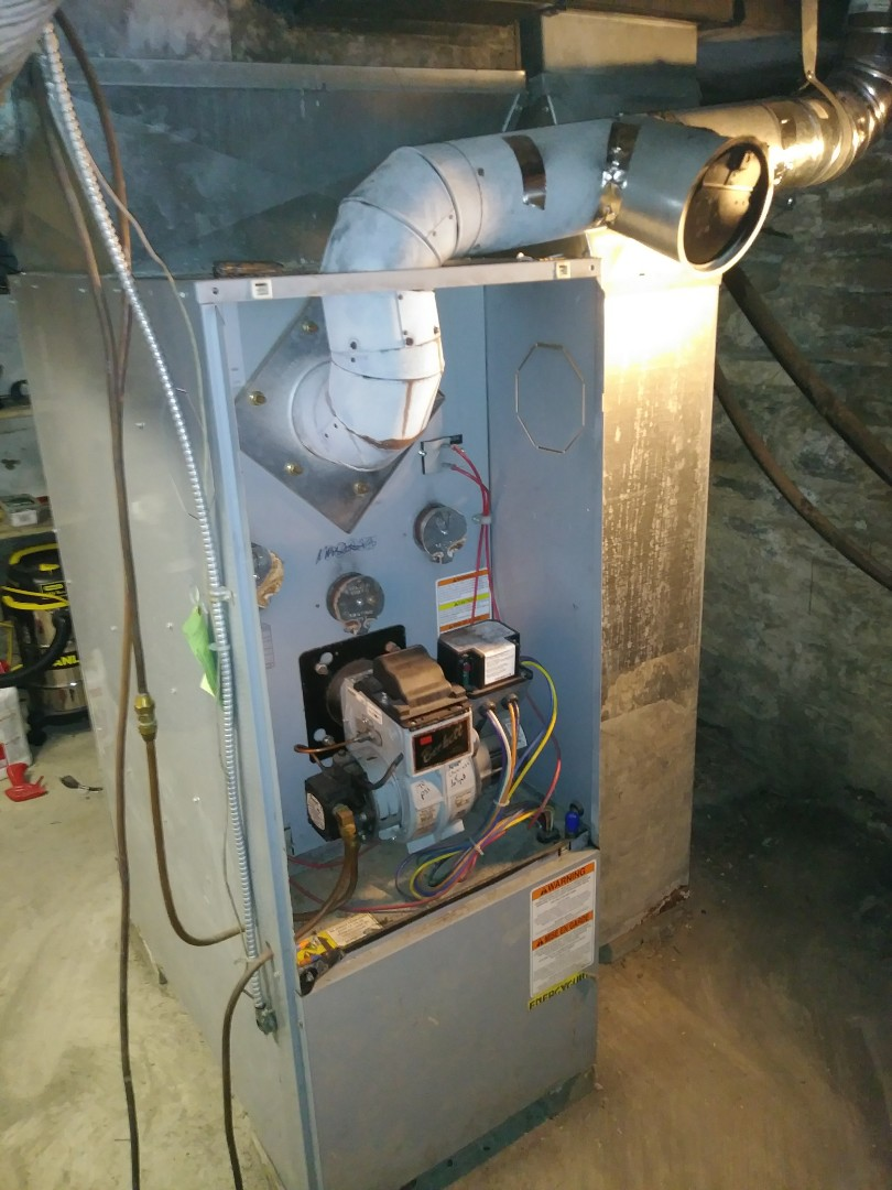 Tearing out oil furnace installing new 90 percent gas furnace