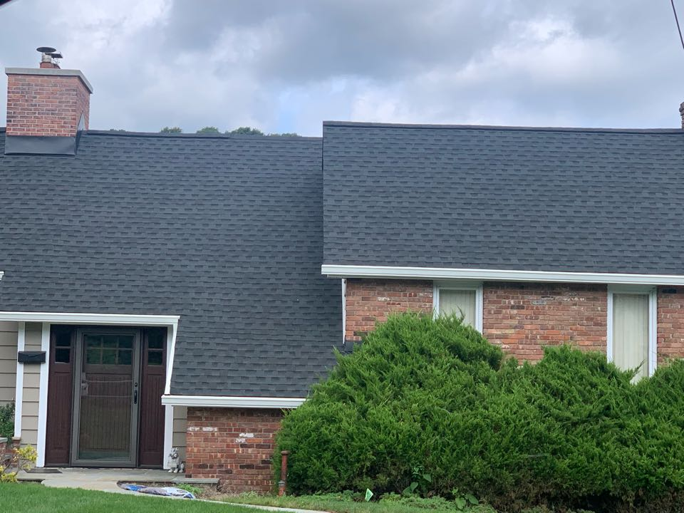 """Sparta, NJ - Completed Job in Sparta, NJ. This beautiful house on the lake has GAF Timberline HDZ - Charcoal Shingles. Along with 6"""" white gutters and leaders. Topped with new white soffit and fascias and leaf relief"""