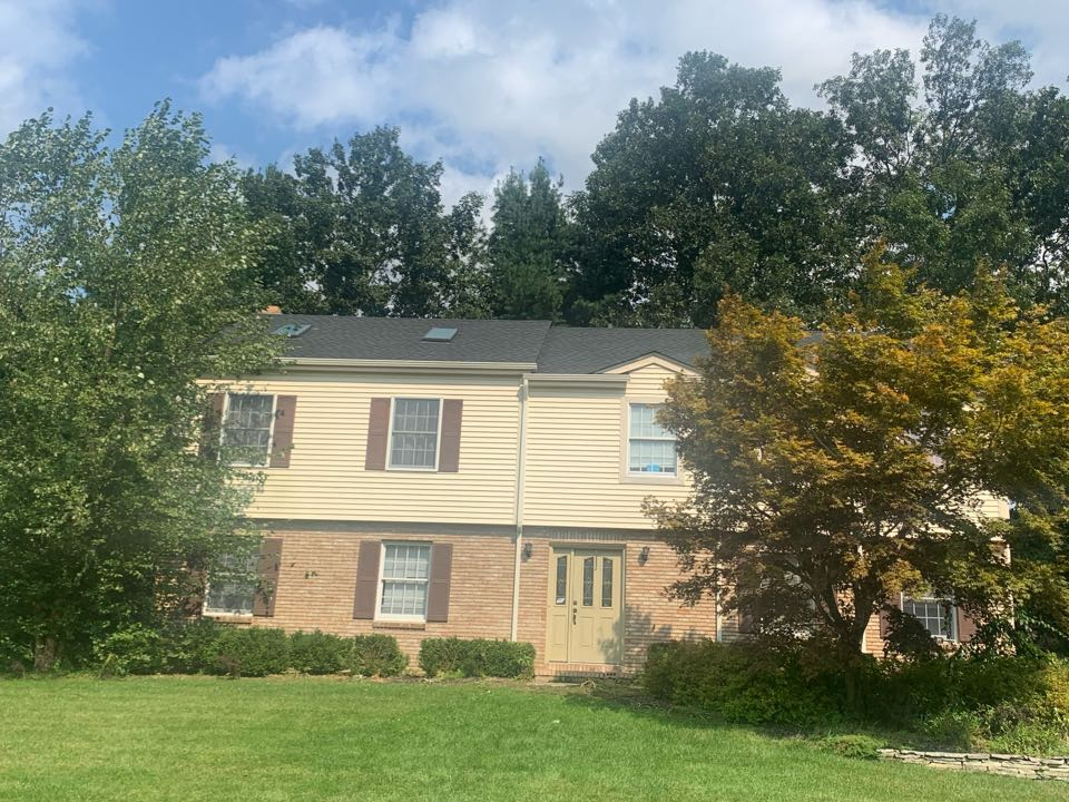 """Stanhope, NJ - Completed Job in Stanhope, NJ. GAF Timberline HDZ - Charcoal shingles with Golden Pledge Warranty. 5"""" gutters and leaders were also done in the color Almond. Skylights were installed to top this job off."""