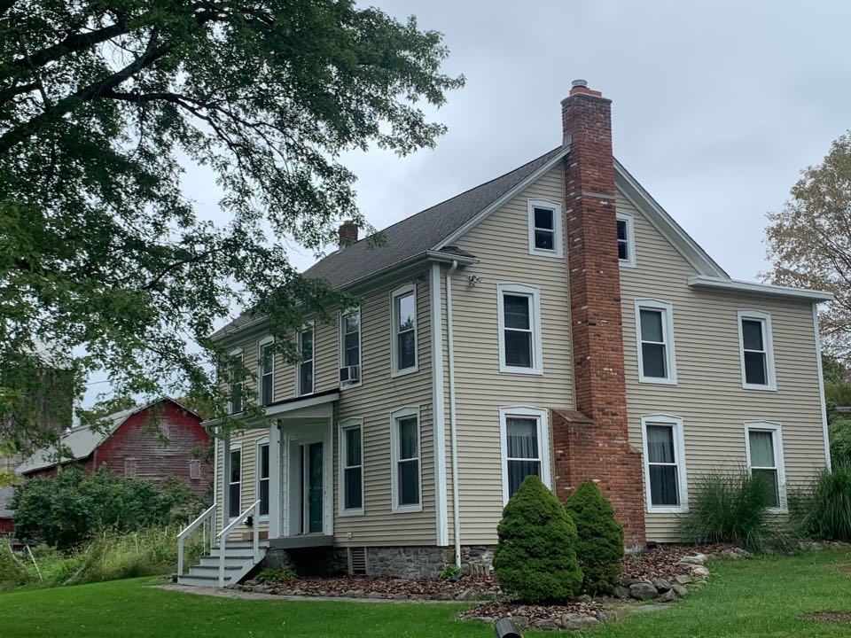 Branchville, NJ - Completed Job in Branchville, NJ. Main roof is GAF Timberline HDZ - Weathered Wood. Lower roof was done in white TPO. The front porch roof was completed in Snaplock standing seam Dark Bronze metal.