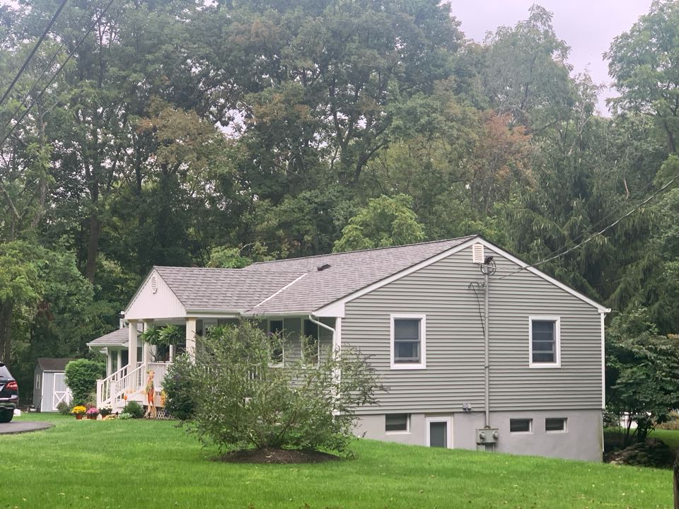 """Newton, NJ - Job completed in Stillwater, NJ. Mastic Quest D4 siding in Scottish Thistle was put on, along with 5"""" white gutters and leaders. Anderson 400 series windows were also put in to top this job off."""