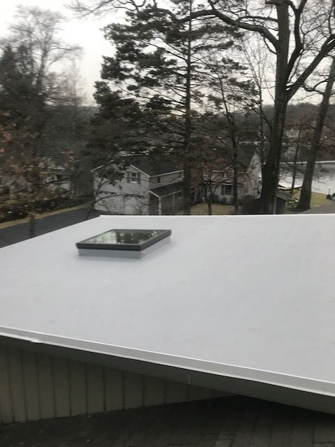 Flat roof replacement - Gray TPO Flat Roof installation with curb mount Skylight