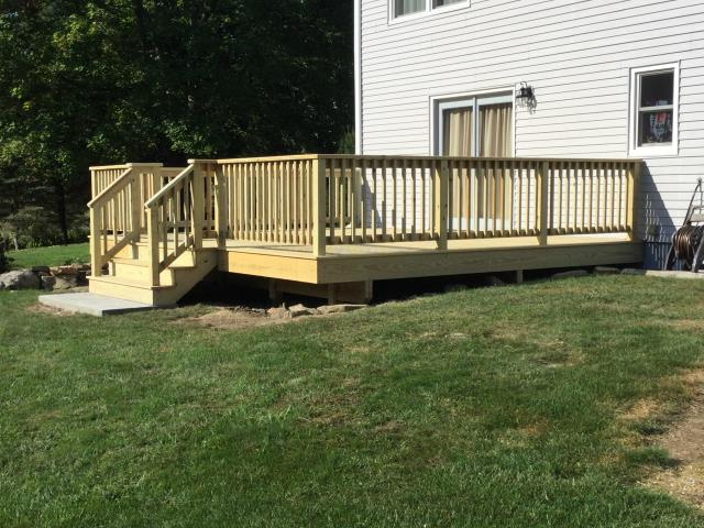 Deck Replacement was done with Pressure Treated Wood - Installed Concrete Pad