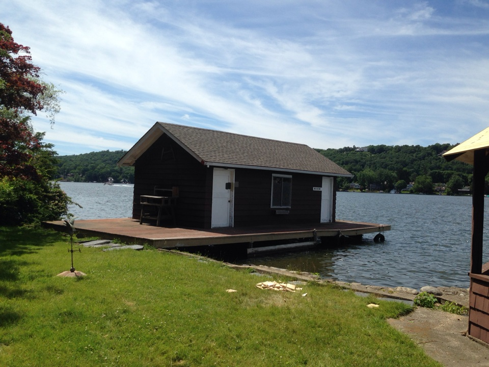 Boat house roof on Lake Mohawk in Sparta NJ, using GAF Timberline HD weathered wood shingles.