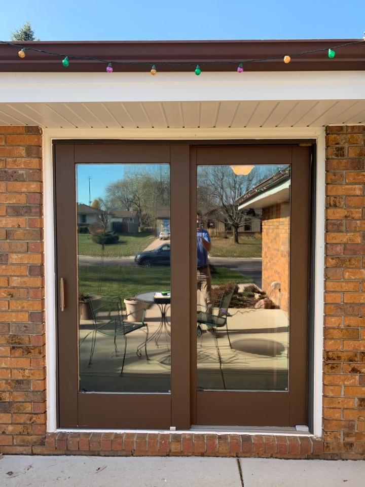 New Berlin, WI - Updating a patio door in beautiful Regal Manors neighborhood with a Provia Endure Patio Slider!