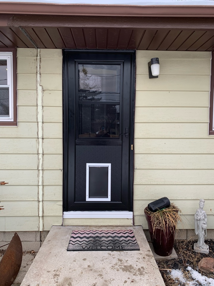 West Allis, WI - Beautiful new Provia Entry Door system with new storm door with doggie door feature for easy access in and out! Way more efficient than the alternative old entry and storm which were mostly propped open with a stick even in our winter months!