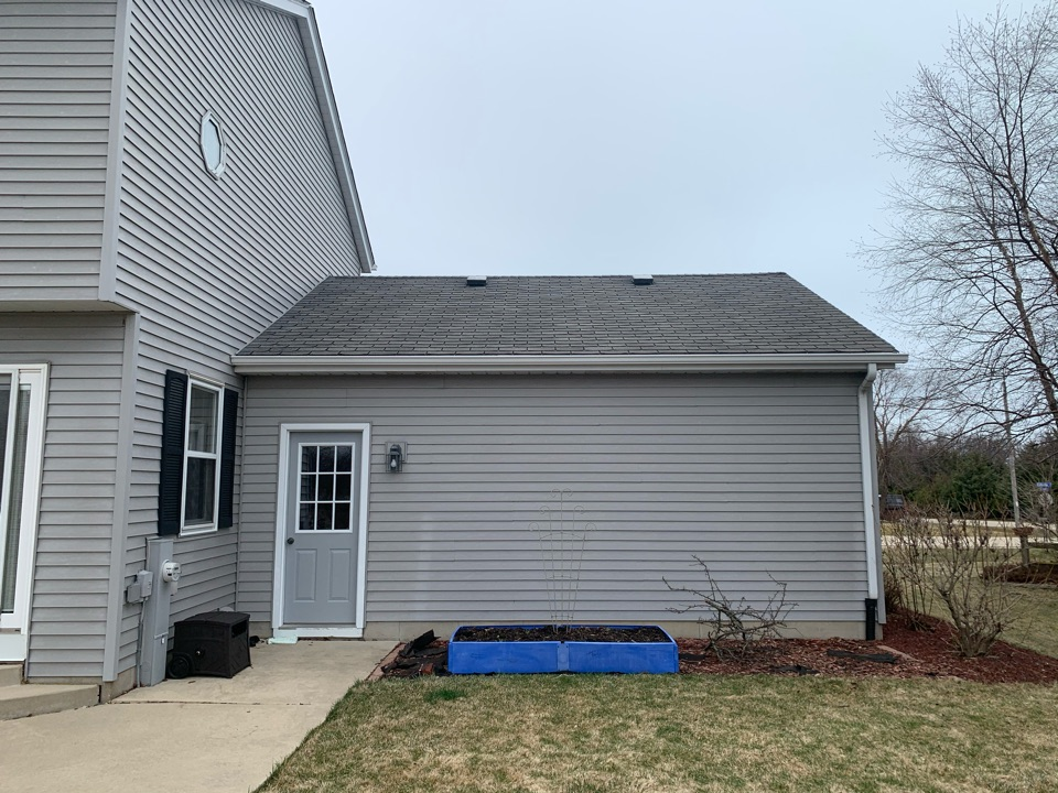 Racine, WI - Curled and brittle shingles can potentially lead to blow offs and roofing leaks. Replacing with our GAF roofing system!