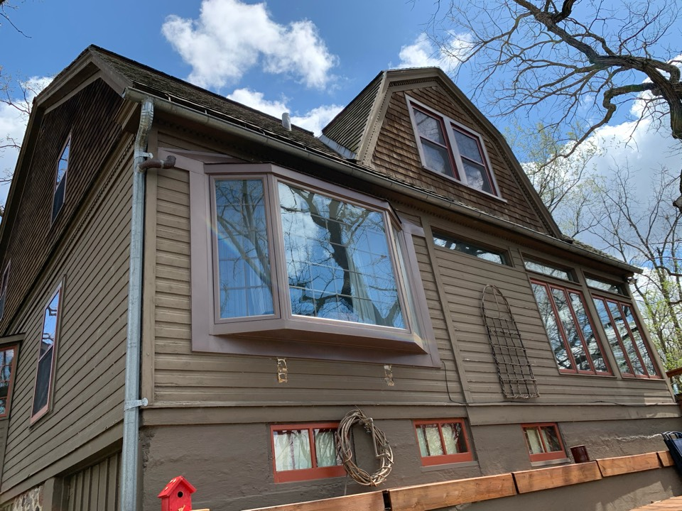"Mukwonago, WI - Replacing old steel gutters that are rusted and now leaking in spots with new 6"" aluminum color matched gutters! Better appearance as well as performance."