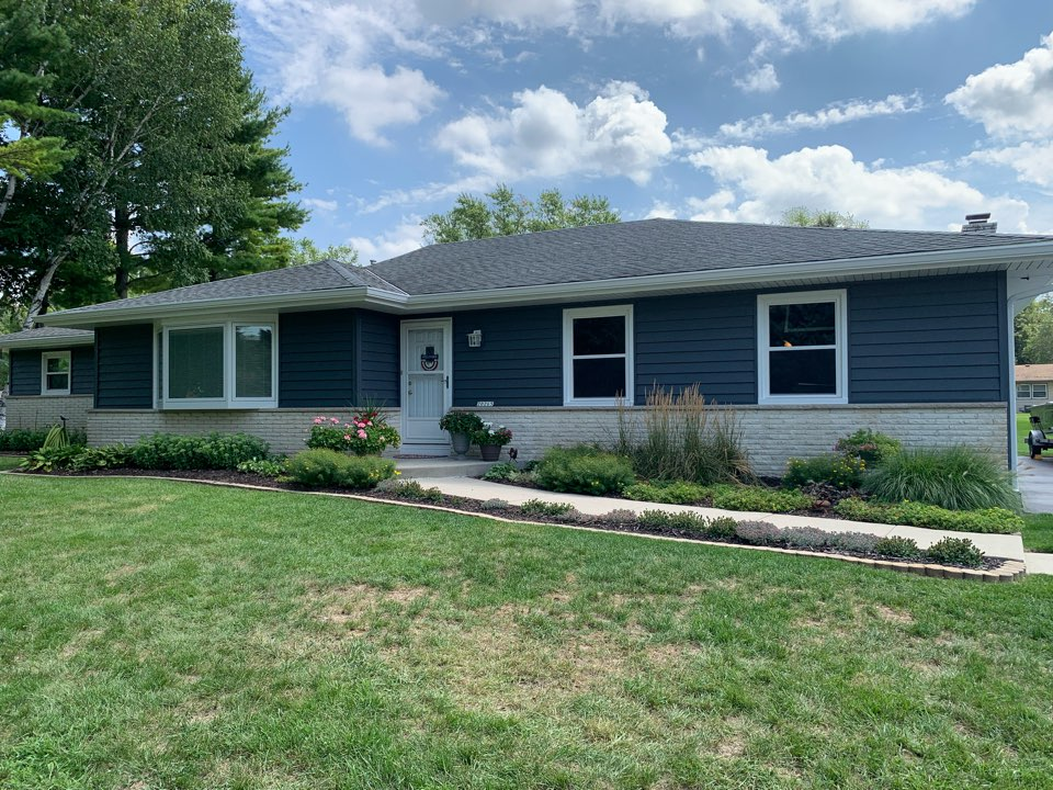 """Brookfield, WI - Beautiful new look for this Brookfield home with our Preservation insulated vinyl siding, new triple pane windows, ventilated soffit, and 6"""" gutters! This new look is just perfect!"""