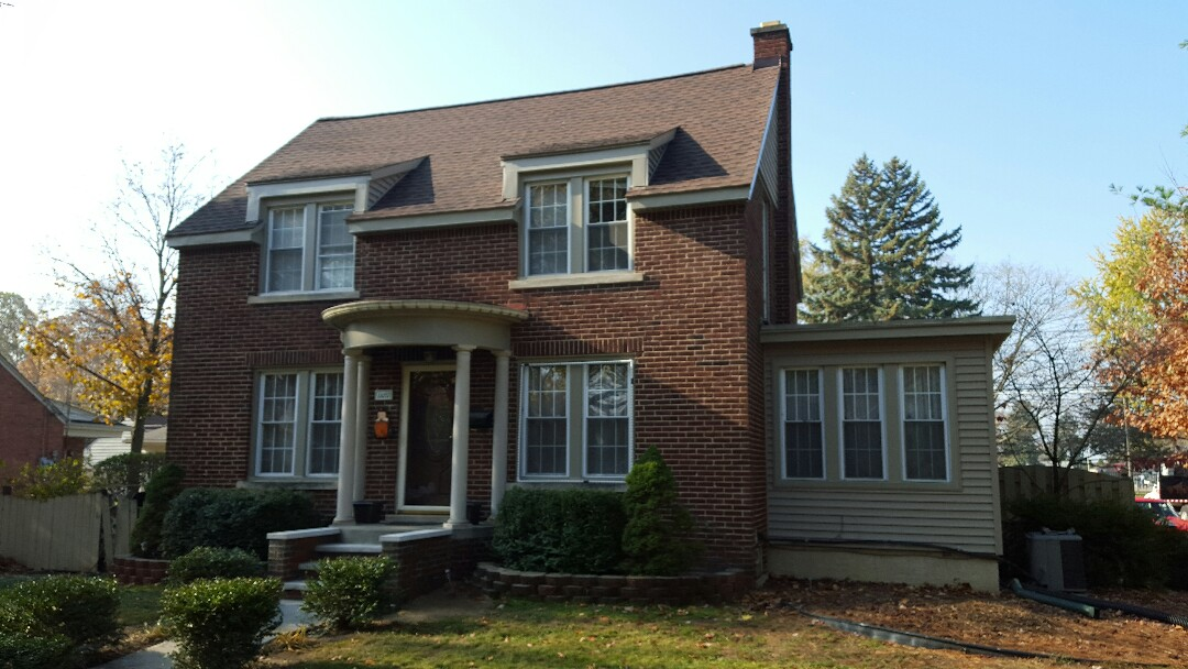 Livonia, MI - New roof, vinyl siding, seamless gutter and masonry porch
