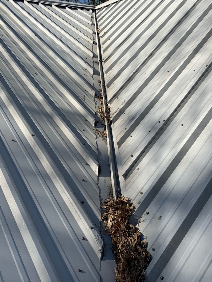 New Caney, TX - Out in  Northcrest today looking at a leak on a metal roof. It is important to routinely maintenance any R panel roof with exposed fasteners so the screws don't rust and create never ending leak problems