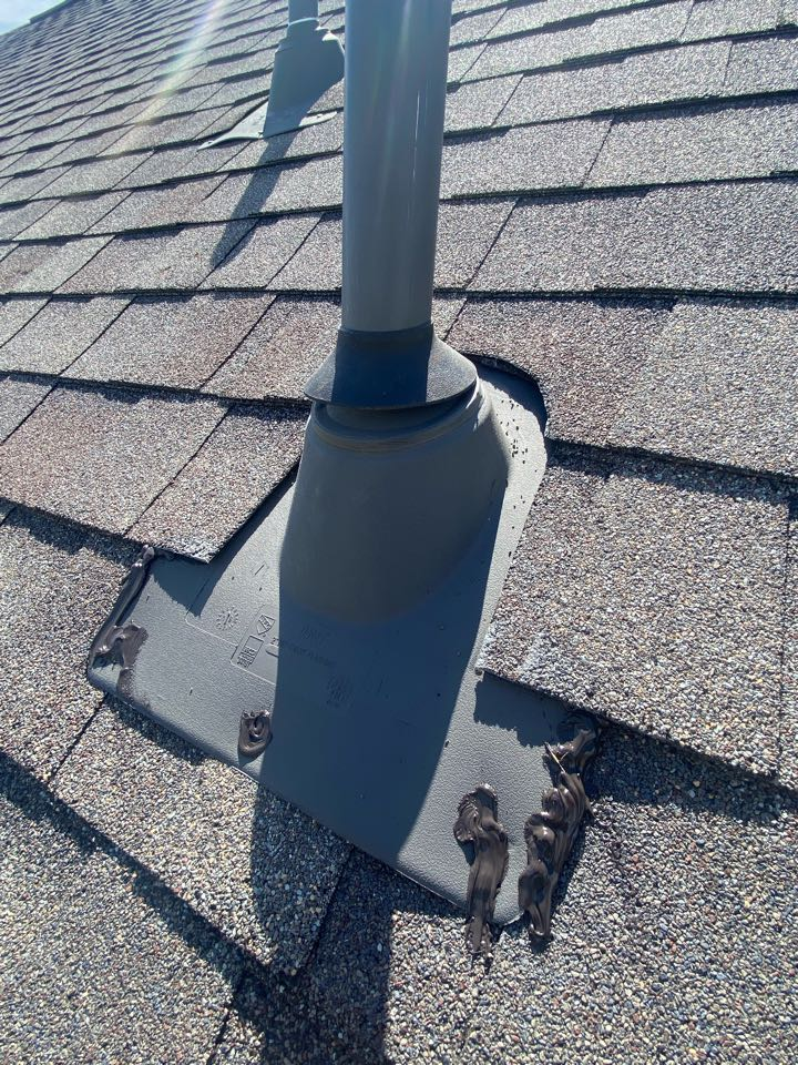 Cypress, TX - A homeowner noticed a leak on the ceiling in their bathroom. After we provided an estimate to fix the problem, we installed a new neoprene pipe collar and properly sealed  the roof jack to eliminate the leak.
