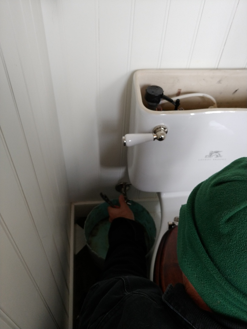 Mill Valley, CA - Relacing toilet to tank gasket.