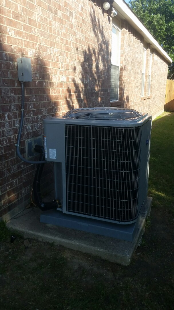 Installed Carrier condensing unit for a family in Grand Prairie.