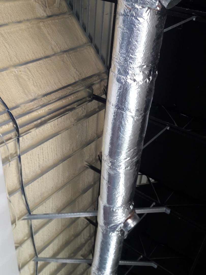 Pasadena, TX - wrapping ductwork for Aqua-tots in Houston.