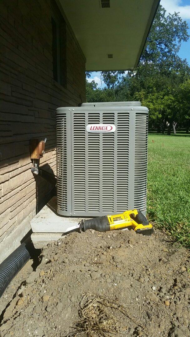Aledo, TX - Leveled Lennox condenser at a house in Aledo.