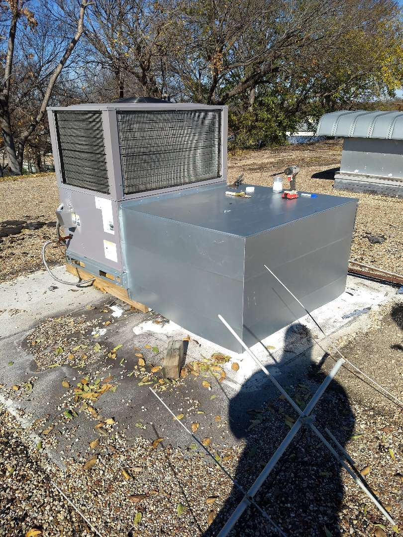 Haltom City, TX - Installing cover overexposed ductwork on rooftop in haltom